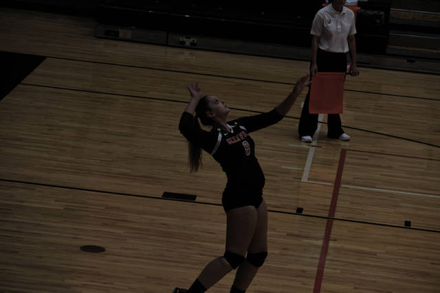 New Boston's Ali Hamilton gets ready to serve a ball against Eastern.