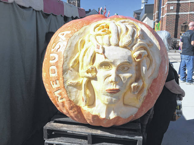 Vendors carved giant pumpkins in the streets of downtown.
