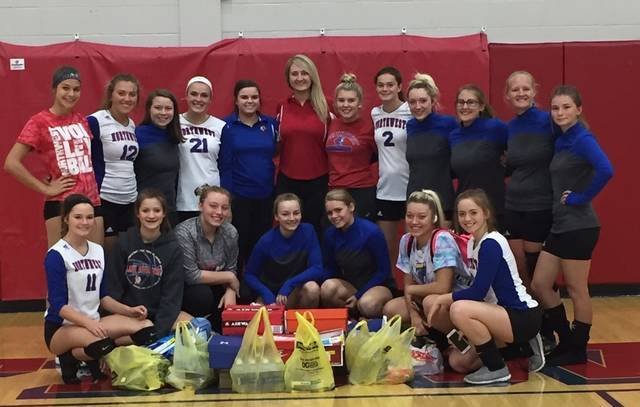 Northwest Varsity and Junior Varsity Volleyball teams with their coaches Taylor Cantrell and Alyssa Sparks together to make care packages