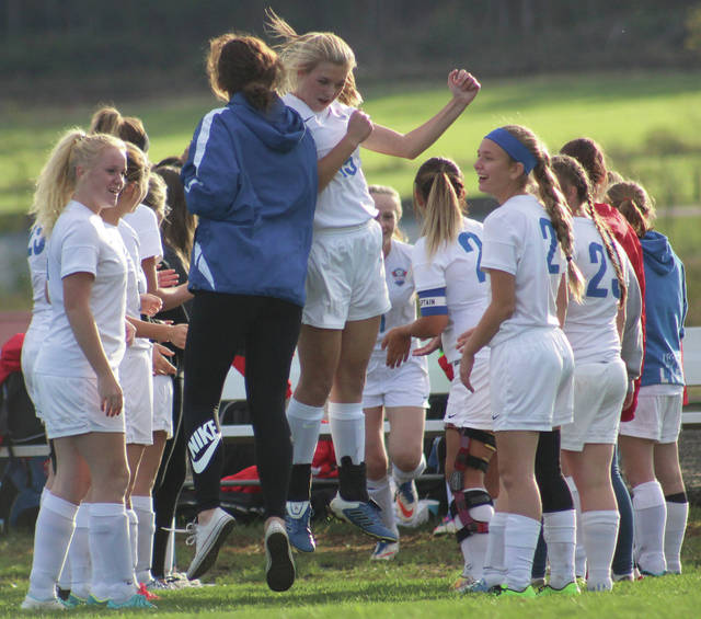 Northwest's Ellie Curtis gets hype before the game.