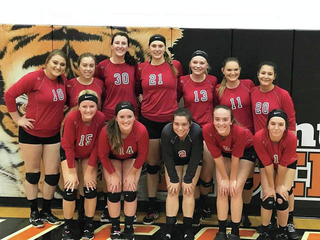 The 2017 Minford Falcons' volleyball program poses after winning a sectional title by defeating Ironton in straight sets this past Saturday.