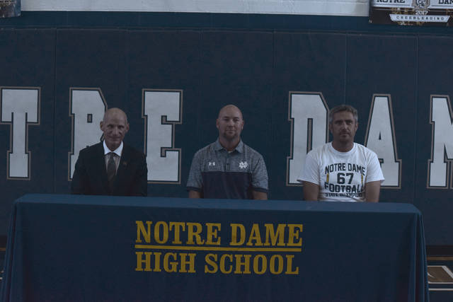 On Friday afternoon, Notre Dame High School officially made their hiring of a new athletic director official as Bob Boldman was named to take over the helm. Boldman will also serve as the school's strength and conditioning coach in addition to his role as the school's athletic director. Sitting beside Boldman (center) are Notre Dame High School principal Thomas Walker (left) and Jake Emnett (right).