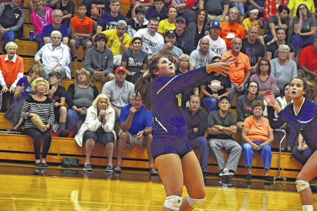 Notre Dame's Cassie Schaefer attempts to set the ball for an attack against Wheelersburg.