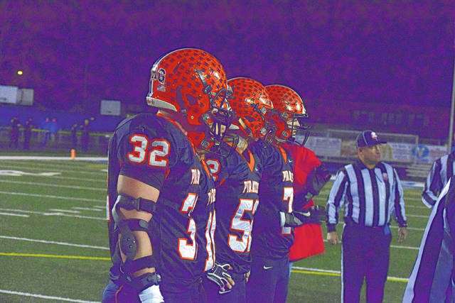 Wheelersburg captains Xander Carmichael, Bryson Keeney, Alex George, and CJ Hall come to the middle of the field for the coin toss.
