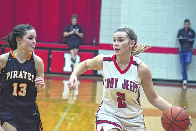 South Webster's Ellie Jo Johnson looks for a passing lane as Wheelersburg's Abbie Kallner applies pressure.