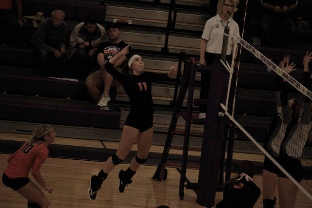 Wheelersburg's Adyson Rase rises up for an attack attempt on Thursday evening.
