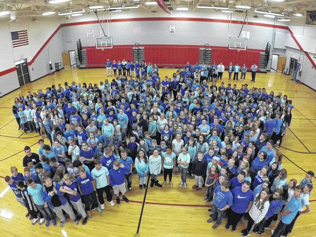 """Students come together to form the """"hope"""" butterfly symbol."""