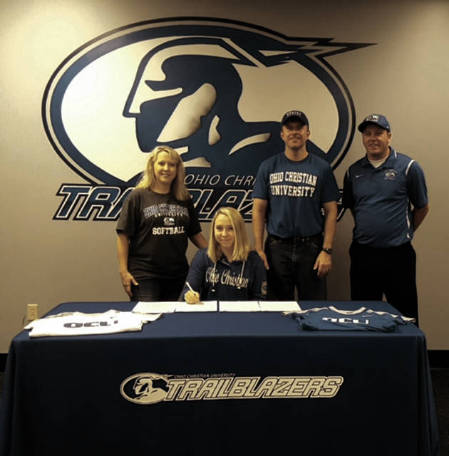 Softball standout Julia Swain, who, along with Hannah Oliver, comprises a star softball pitching rotation at Clay, signed with Ohio Christian on Saturday, Nov. 4 in a signing ceremony held on the OCU campus in Circleville. From left to right are Shelly Evans (mom), Swain, Gary Evans (stepdad), and Ohio Christian head coach David Polly.