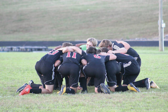 South Webster starters huddle before a match against Minford earlier in the season.