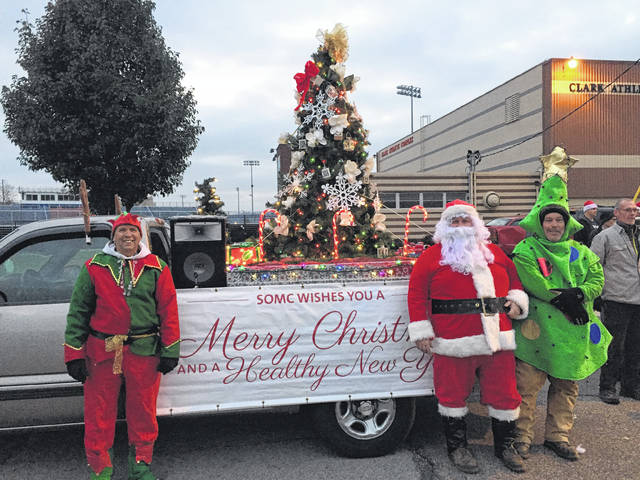 SOMC's santa, elf and christmas tree ready for the parade.