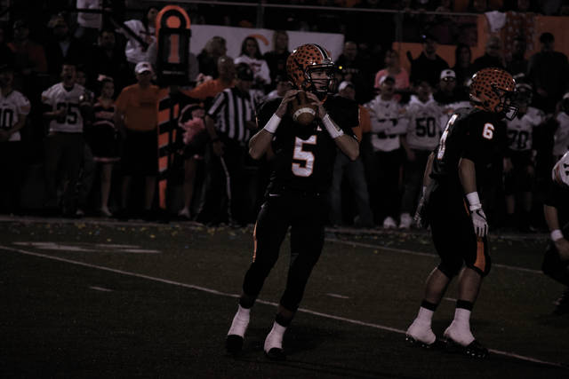 Wheelersburg's Trent Salyers drops back to throw against West. Salyers holds the all-time school mark for passing yards in a season, and, with one touchdown, can break a tie with Eddie Miller III for most touchdown passes in a season as well.