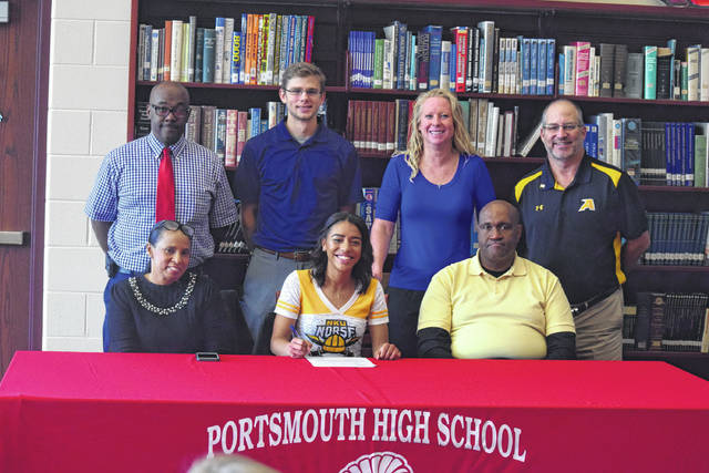 Portsmouth's Lynsey Shipley, who is arguably the Trojans' most decorated track athlete in school history, signed with Northern Kentucky on Friday evening. Front row from left to right: Lynn Shipley (Lynsey's Mom), Shipley, Juan Shipley (Lynsey's Dad). Back row from left to right: Arthur Lard, Brad Liston, Amy Hughes, Joe Albrecht.
