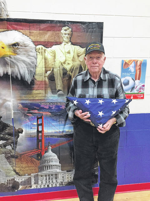 Navy Veteran Russell Maddix, 91, was presented with the flag following the ceremony.