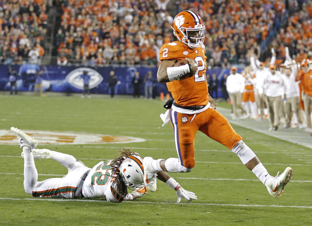 FILE - In this Dec. 2, 2017, file photo, Clemson's Kelly Bryant (2) runs past Miami's Sheldrick Redwine (22) for a touchdown during the first half of the Atlantic Coast Conference championship NCAA college football game in Charlotte, N.C.Bryant answered the question of how the Tigers would fare in life without Deshaun Watson. Bryant is completing 67.4 percent of his passes and has also run for 11 touchdowns. (AP Photo/Bob Leverone, File)