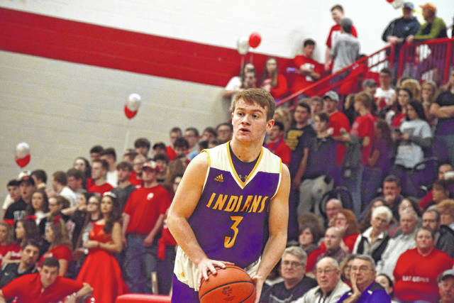 Valley's Andrew Shope sets his feet for a three-point shot on Tuesday evening.