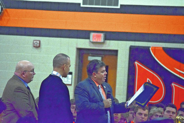 Scioto County Commissioner Chairman Bryan Davis reads off the proclamation honoring the 2017 Wheelersburg football program for winning the program's second state championship.