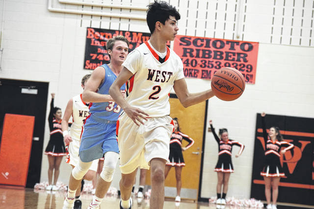 West's Brandon Moore moves up the floor with the basketball.