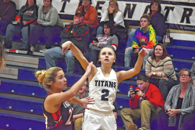 Notre Dame's Taylor Schmidt watches her three-point shot as it heads toward the rim on Monday evening against Eastern.