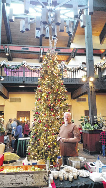 Area garden clubs hung bulbs and beads on an estimated 38 trees as part of the Shawnee Lodge Christmas decorating.