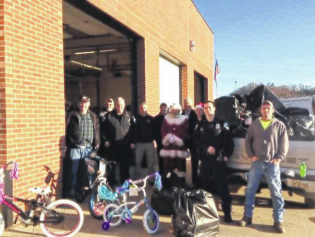 Portsmouth Police Department joined together with Santa Clause to deliver gifts.