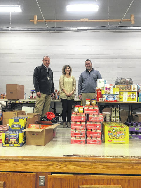 Jeff Rase, Guidence Counselor, Aimee Elswick, Jeremy Clark- Valley Elementary Principal standing with the food