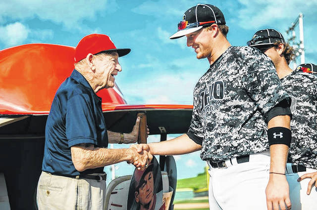 Gene Bennett greets an Ohio Warhawks player during the Gene Bennett Baseball Classic festivities back in 2014. The Gene Bennett Baseball Classic, which has hosted as many as 21 teams across the United States and Canada, was one of the many pleasurable achievements that Bennett helped bring to the Scioto County area.