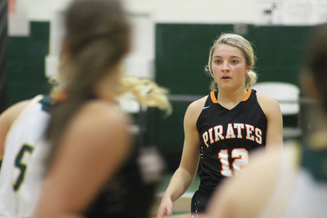 Wheelersburg's Ellie Ruby brings the basketball up the floor for the Lady Pirates.