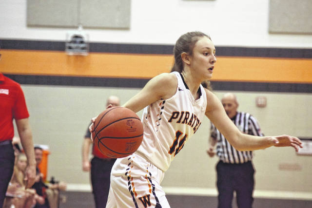 Wheelersburg's Kaylee Darnell drives toward the basket.