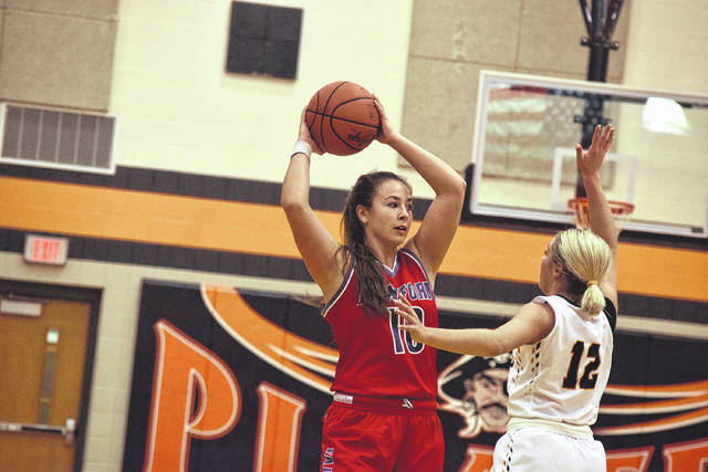 Minford's Erin Daniels looks for an open target against Wheelersburg last Thursday.