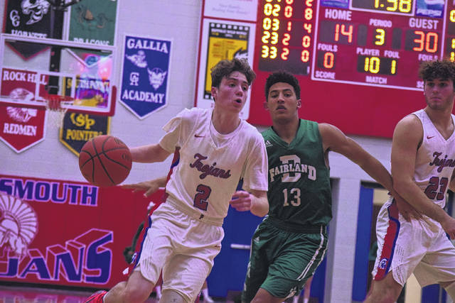 Portsmouth's Matthew Fraulini drives past Fairland's Keedrick Cunningham on Tuesday evening.