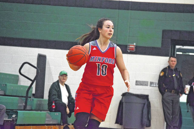 Minford's Erin Daniels moves up the floor with the basketball. Daniels sits just seven points away from the Minford girls basketball program's all-time scoring mark.