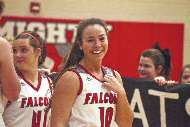Minford's Erin Daniels smiles after eclipsing the girls basketball program's all-time point total, which was previously set by Cheryl Preston-Bolender (1,379).