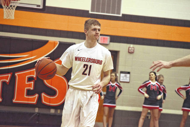 Wheelersburg's Cole Lowery sets up the offense against Minford.