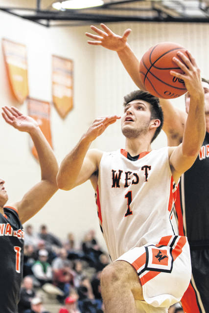 West's Jordan Frasure goes up for a bucket on Friday evening against Waverly.