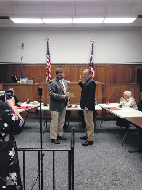 Dunne takes oath led by Haas
