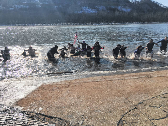 Nearly thirty jumpers emerging from the Ohio River.