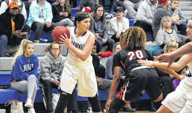 Shawnee State's Ashton Lovely holds the ball out on the right wing.