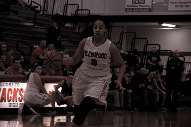New Boston's Peyton Helphinstine drives to the basket against Miller on Sunday afternoon in Jackson.