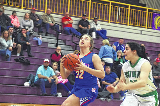Northwest's Abby Baer gathers for a layup attempt.