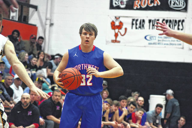 Northwest's Hunter Berry looks for an open teammate on Tuesday evening.