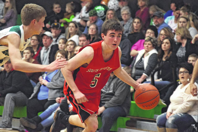 South Webster's Andrew Smith dribbles into the lane on Tuesday evening.