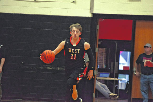 West's LT Maynard brings the basketball up the floor for the Senators.