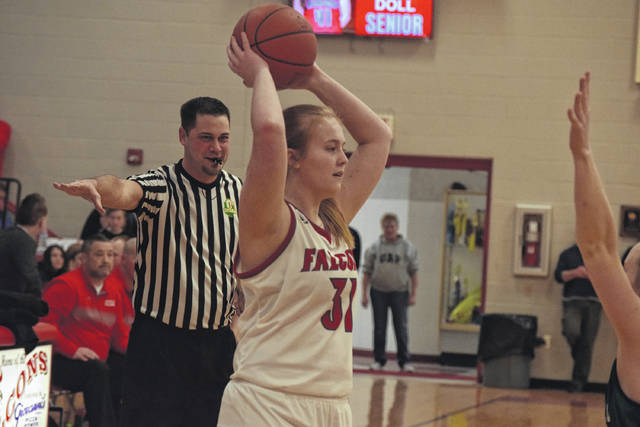 Minford's Marissa Watters looks for an open teammate.
