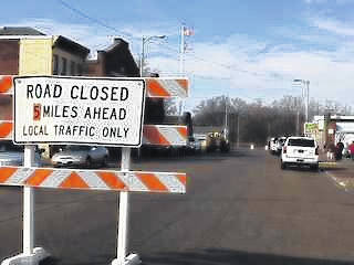 Baricades in Portsmouth's downtown business district warn residents of flood wall gates that have been closed to protect the city from rising waters on the Ohio River. Additional gates are now being erected due too the threat of more rain.