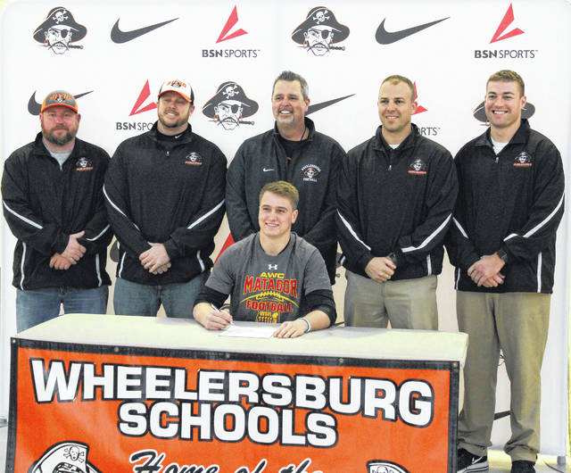 Wheelersburg's Xander Carmichael, who starred in all three phases of the game of football during the Pirates' state title run, signed with Arizona Western to play junior college football at the Yuma, Ariz.-based program.
