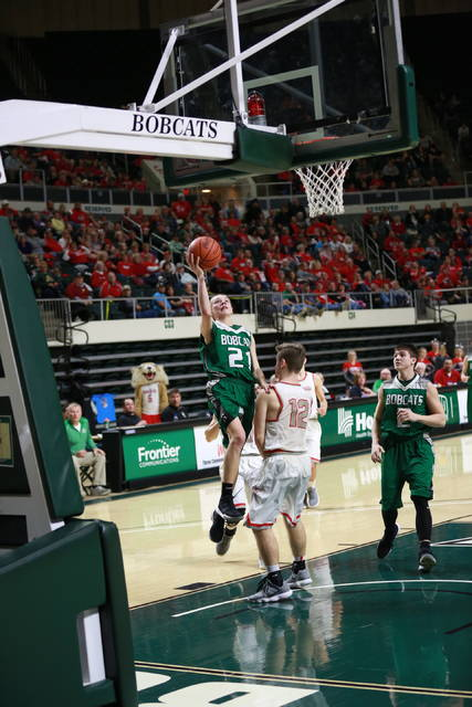 Green's Zach Huffman goes up for the and-one layup that gave Green its first lead of the second half.