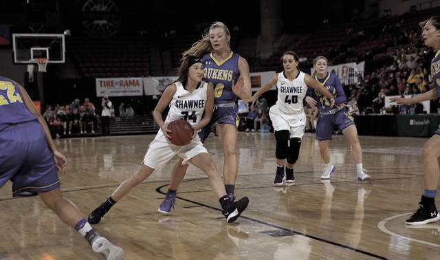 Shawnee State's Bailey Cummins is flanked by Wayland Baptist's Deborah VanDijk as the sophomore drives into the lane on Friday evening.