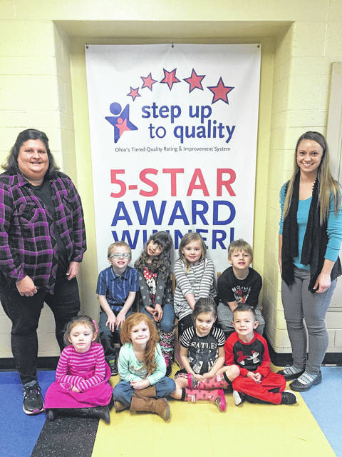From left, Christy Knauff, Preschool students from both classrooms, and Davida Justice.