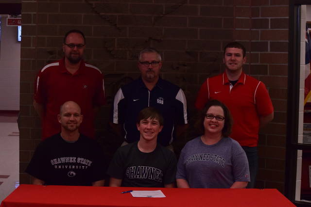 Minford's Eli Cordle (pictured here in middle) signed with Shawnee State University in a signing ceremony last Tuesday at Minford High School.