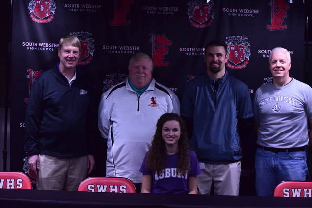 South Webster's Grace Raison (sitting, center) signed with Asbury University last Thursday to run for the Eagles in cross country.